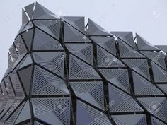 geometric building with metal cladding - Stock Photo - Ideas of Stock Photo Photo - Picture of geometric building with metal cladding stock photo images and stock photography. Metal Facade, Metal Cladding, Metal Buildings, Building Skin, Building Facade, Building Design, Parametrisches Design, Mall Design, Cladding Design
