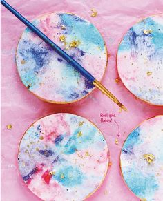 Watercolor cookies. The instructions are WAY down at the bottom of the page, but it starts off with a pretty awesome bit of cake decorating. See the related pins for similar examples.