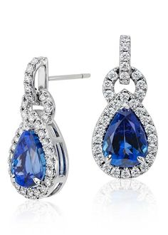 The brilliance of color is captured in these tanzanite and diamond earrings framed by round diamonds in 18k white gold.