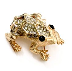 Weinberg New York Frog Brooch  Measures: Approx. 1 1 /2 x 1 3/8  Mark: Weinberg New York  Condition: Very Good vintage condition  What a wonderful frog brooch from Weinberg New York  - Composed in brushed gold tone metal  - Covered in pave ice crystals - Black glass cabochon eyes  - Very three dimensional design captures the frog so well!  Heres a great piece of vintage jewelry with a ton of style & personality!       Please do keep in mind that any vintage and/or antique m...