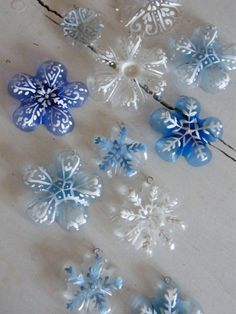 Wonderful idea! Can also use other colours for floral themed~!   Another upcycling idea: Cut off bottoms of water and soda bottles and paint snowflakes on them. Use hole punch near one edge for hanger...yarn, ribbon, wire, etc.  Simple...good craft to work with children of almost any age.  Too bad we dont drink soda!!