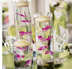 Wedding Reception Centerpieces created with cylinder vases, floating candles and small flowers by Jason Shires of QMEP Wedding Reception Decorations On A Budget, Spring Wedding Centerpieces, Wedding Reception On A Budget, Orchid Centerpieces, Simple Centerpieces, Diy Wedding, Wedding Flowers, Wedding Planning, Centerpiece Ideas