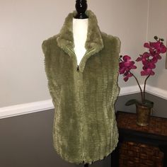 Green faux fur vest Super hip and fun! Faux fur vest. Tear in the inner vinyl lining. Jackets & Coats Vests