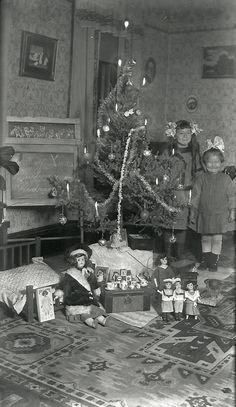 Vintage Christmas Photograph ~ Murnie and Nedra Treace. Christmas Day: 1912 Notice their sparkly hair bows and their sweet dolls under the tree!