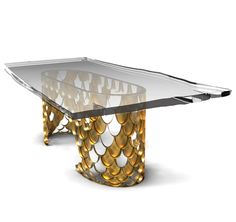 Koi Dining Table   Its natural color mutations reveal their capacity to adapt, just like the set of KOI tables with table tops in glass or marble that you can choose to better fit in your ambiences. The KOI scales from the sides of the tables shine and reflect-on its brass surface- the sun caught throughout the clear water. Item #  3008
