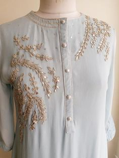 Featuring this Powder Blue Gota Patti kurti with fine traditional Gota Patti handwork on the front. The sleeves are with pintucks and sequins detailing. Kurta is straight fit with side slits. Fabric: Viscose Georgette Lining: Shantun Embroidery On Kurtis, Hand Embroidery Dress, Kurti Embroidery Design, Embroidery Fashion, Zardozi Embroidery, Neck Designs For Suits, Dress Neck Designs, Designs For Dresses, Blouse Designs