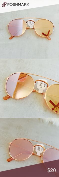 LOFT Rose Gold Double Bridge Round Sunglasses Retro meets sporty in these irresistible sunnies. Rose Gold frames and rose gold mirrored lenses. 100% UV protection. Comes in a soft drawstring pouch. LOFT Accessories Sunglasses