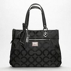 Coach Poppy OP Art Glam Tote. This purse went to Italy and back. I use it every day and it hands down has been the best bag I ever had