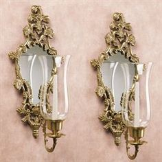 The lavish Athea Mirrored Wall Sconce Pair features a mirror flanked on each side by scrolled flowers, with a bloom flourish on top. Wall Lamp, Mirrored Wall Sconce, Flower Room Decor, Brass Wall Sconce, Wall Candles, Mirror Wall, Candle Wall Sconces, Mirror, Wall Grille