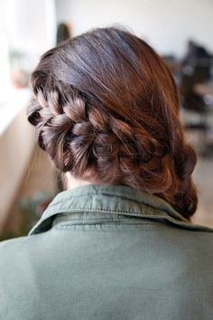 Gonna do this to Emma's hair.  Total kickassery DIY Katniss Braid, No Hunger Games Required #refinery29
