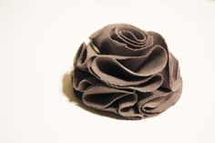 this looks like a fun, easy project with which you could really get carried away LOL  DIY Wedding Challenge 2010: Fabric Flower - Project Wedding