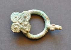 Amlash Bactrian bronze belt buckle 1, 1st millenium B.C. Amlash Bactrian bronze belt buckle with bird head and spirals as tail, 5.3 cm long, 23.4 gr weight. Private collection