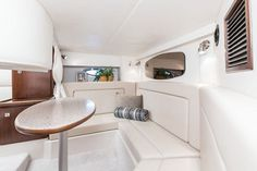 Cruisers Yachts 310 Express: Just abaft the galley is a wet head, small enough to not take up valuable salon room, but large enough to be functional. There is storage behind the sink and below but not above behind the mirrors.