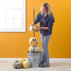Make a Pumpkin Tower. I want one that says BOO, and one that says EKK on either side of my door. Going to try it with fake pumpkins so I can reuse them every year.