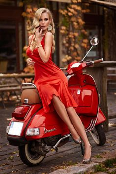 a lovely dress, nice shoes, a pretty model in an unusual pose and a stylish scooter make for a fabulous photograph. so glamorous, and so very red, i almost want to buy a scooter. erotic-mind-teaser: Matching the motor with the dress Scooter Girl, Vespa Girl, Vespa Scooters, Motor Scooters, Vespa Motorcycle, Vespa Vintage, Model Auto, Biker Chick, Motorcycle Girls