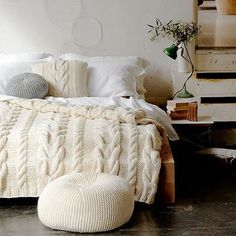 Love the sweater-looking comforter... could be a great idea for a tiny apartment. Gives it a tiny, but cozy feel.