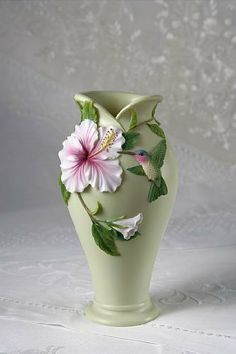 """Hummingbird  Hibiscus Table Vase - Ibis  Orchid Design Collection by Ibis  Orchid. $40.99. 5"""" W x 9.25 Inches High. Part of the Hummingbird  Hibiscus Collection. Durable Bonded Marble. Fine Detail. Nicely Boxed. This Hummingbird and Hibiscus Table Vase stands approximately 9.5"""" tall and is about 5.5"""" in diameter.  So beautiful in it's design that you need not worry about adding flowers to it, yet waterproof if you so elect.   One of several Hummingbird and Hibiscus products..."""