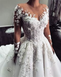 Custom Long Sleeve Wedding Gowns You Can Afford - - This sheer long sleeve can be recreated for you with any design preferences. We are dress makers who produce custom and of couture designs for less. Source by darius_custom_wedding_dresses Wedding Gowns With Sleeves, Cute Wedding Dress, Long Sleeve Wedding, Dream Wedding Dresses, Bridal Dresses, Perfect Wedding, A-line Wedding Dresses, Lace Sleeve Wedding Dress, Sheer Wedding Dress