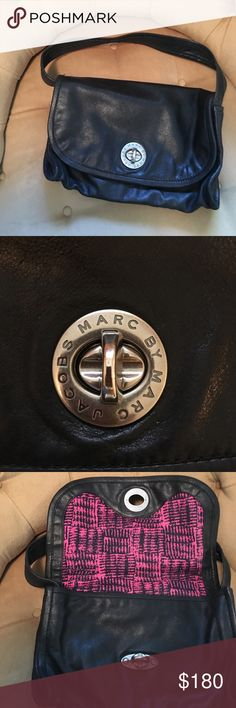 Marc by Marc Jacobs black shoulder bag Super adorable Marc by Marc Jacobs black bag with turn key silver accent. Interior zip pocket. Includes signature dust bag. The interior is a gorgeous hot pink print. Used. Marc by Marc Jacobs Bags Shoulder Bags