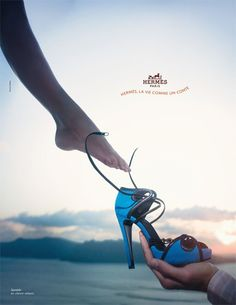 Cinderella wedding shoe photo. Dont like the picture and the shoe. But great idea and inspiration for idea of wedding shoe and a photo of the groom putting on the shoe since its my favorite fairytale.