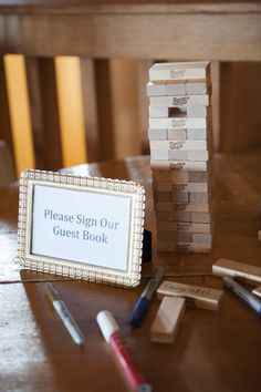 Guest book alternative - Jenga blocks signed by guests. #GuestBook #Wedding #Whimsical #Games