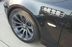 BMW E60 M5 with gunmetal powdercoated rims and matching fender vents