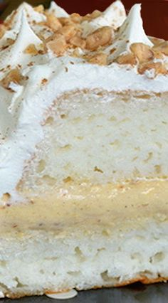 Pumpkin Toffee Angel Food Cake ~ Angel Food Cake gets a fun holiday twist by being filled with a no bake pumpkin cheesecake filling. Perfect for any dinner party.