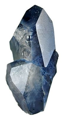 """Benitoite is a rare blue barium titanium silicate mineral, found in hydrothermally altered serpentinite. It fluoresces under short wave ultraviolet light, appearing bright blue to bluish white in color. First described in 1907 by George D. Louderback, who named it benitoite for its occurrence in San Benito County, California. It is California's official state gem. Benitiote has a rare 5 pointed crystal form, and an even rarer 6 pointed form, """"star of David"""", with about 24 samples known."""