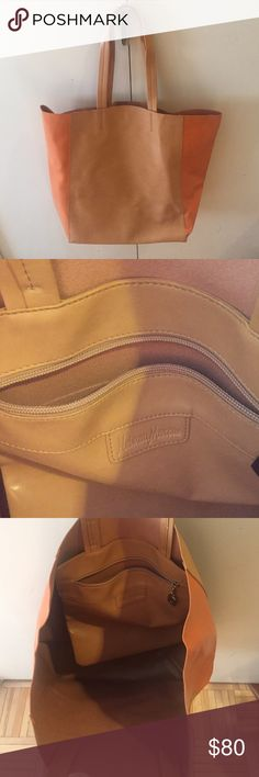 Never used Neiman Marcus tote Tan tote with orange accent. Great leather, never used! Classic Neiman's style! Neiman Marcus Bags Shoulder Bags