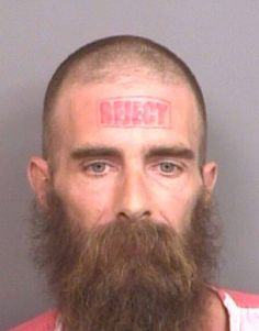 This forehead felon certainly says what's on this mind - or is that head? This unnamed Alabama man (crime unknown) seems to think he is a reject.