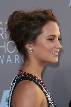 Alicia swept her hair off her face for this red carpet up-do, but kept things loose with strands falling free.