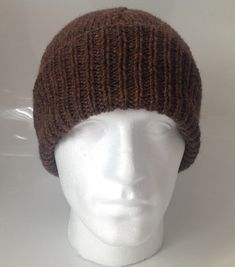 A personal favourite from my Etsy shop https://www.etsy.com/uk/listing/229516131/mens-brown-aran-with-20-wool-beanie-hat