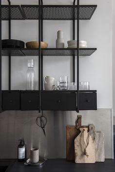black metal kitchen shelving. Beautiful Helsinki Home - via Coco Lapine Design