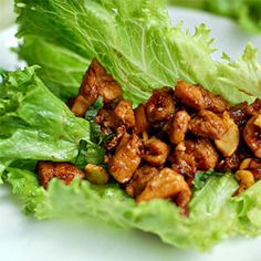 Lettuce wraps are a good combination of savory, spicy and crunchy that I just love. Plus, they're easy. This is a simple recipe for chicken cashew lettuce wraps. Top it off with your favorite hot sauce, basil or more cashews, and you'll have a winner for sure.