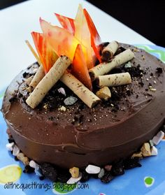 All The Quiet Things: Campfire Cake MY FAVORITE CAKE--note to self--add the candles to the center area by the flames, crushed graham crackers, oreos, and rock candy! Campfire Cake, Campfire Food, Bonfire Cake, Easy Cake Decorating, Cake Decorating Techniques, Decorating Ideas, Decor Ideas, Todo Camping, Easy Desserts