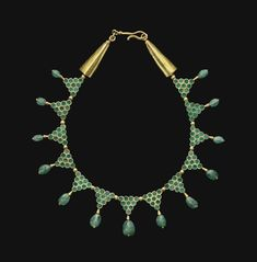 A BYZANTINE GOLD AND EMERALD NECKLACE CIRCA 6TH-7TH CENTURY A.D.