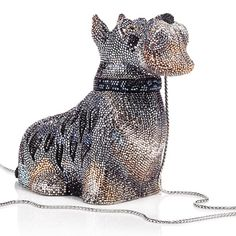 Price: $4,875 at Judithleiber  Do you have a taste for schanuzers? If so, then you are going to absolutely enjoy this one. This is a bag that is in the shape of a schnauzer. When I first saw this, I couldn't believe what I was seeing. It looked just like my friends schnauzer. We know this was a bit on the expensive side, but I absolutely adore my friend, so I decided to get this for her. She was amazed when she saw it. It even had a tuck in chain. It also has black onyx eyes.
