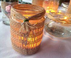 Frascos decorados con arpillera  para velas y velas flotantes.