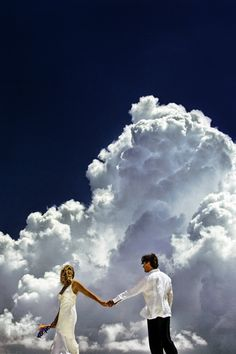 Best Shot 2006.     In the Bahamas I had the b&g for a 'day-after' shoot. I had them walking on a concrete walkway. I shot from a low angle to give them this amazing cloud backdrop. I cropped off their feet so I could decrease the appearance of depth. I wanted to 'push' them into the wonderful bank of Cumulus. Image by David Beckstead