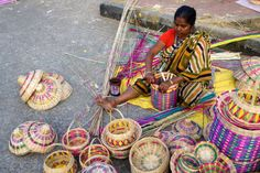 A woman engaged in making handicraft products with cane Handicraft products of West Bengal are world famous Districts abound in artists making such...