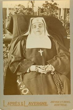 A young nun posed in a chair