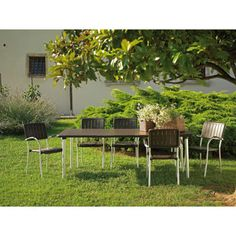 Costco: Nardi® Maestrale 88 in. x 40 in. Table with Musa Armchairs