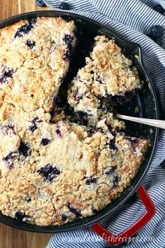 Old Fashioned Blueberry Buckle Recipe -- This streusel-topped coffee cake is studded with fresh blueberries and a hint of cinnamon and ginger. Perfect for breakfast or dessert.