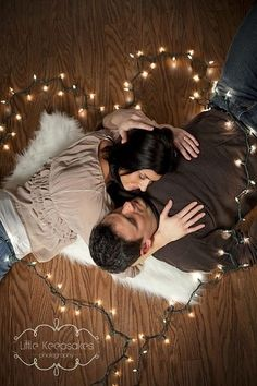 Christmas photo idea for couples. Would be cute to have laying in back and looking up at camera