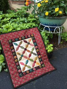 """This is my """"Widdlytinks"""" mini quilt that I will be teaching at The Quilted Crow in Harpursville, NY, beginning on July 18th. It is a six month club called the Simple Whatnots Club and all the quilts are designed by Kim Diehl! Please call Peg at The Quilted Crow to sign up.  I just loved making my first! Debbie Wick Elmira, NY."""