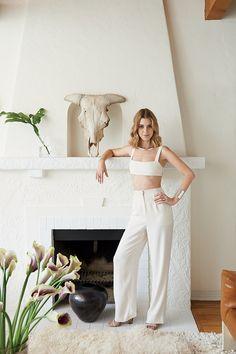 Sophie Buhai at home in Los Angeles, wearing her own jewelry. Vena Cava top. Derek Lam 10 Crosby trousers.