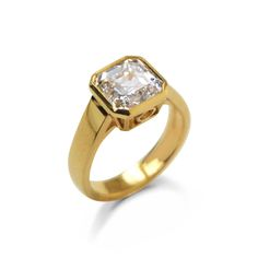 Bespoke diamond rub-over set single-stone ring with an asscher-cut diamond mounted in 18ct yellow gold