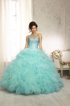 Quinceañera Dresses from Vizcaya by Mori Lee 88098. Beaded Bodice on a Two Tone Ruffled Tulle Ball gown Skirt with Matching Bolero.