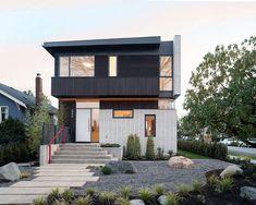 Dark cedar coupled with white bricks to create a unique facade