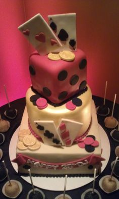 www.eventfullplanning.com  Casino theme birthday cake & cake pops by Confectioneiress, red uplighting